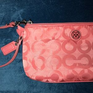 Authentic peachy coral Coach Wrislet, like new.