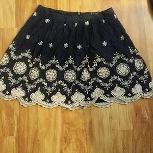 Navy blue, floral skirt.