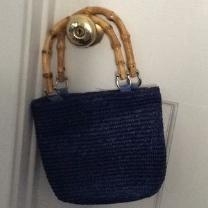 Faux bamboo handled blue handbag