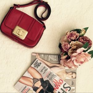 Michael Kors red/cherry crossbody bag.