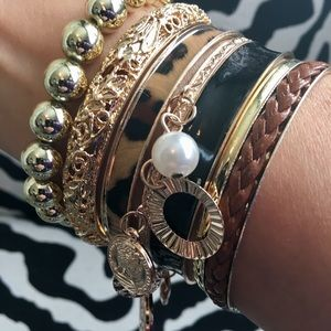 Bundle of 7 gold tone bracelets - new without tags