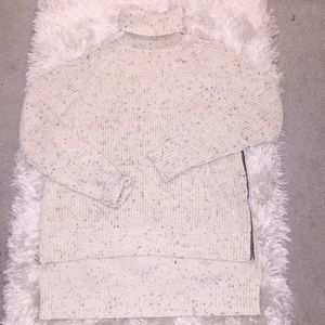 Turtle neck sweater with side zippers