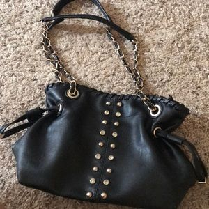 Black purse with gold and crystal accents