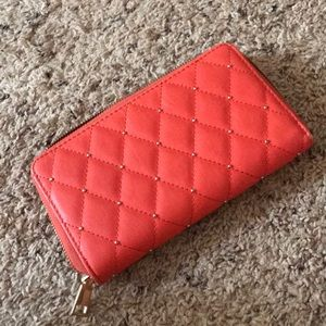 Orangish pink wallet with little gold detailing