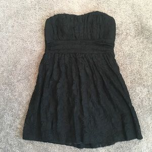 Lacy strapless black dress with back zipper