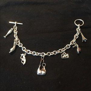 Solid Sterling Silver charm bracelet.